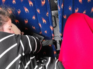 """The """"proper"""" way to sleep on the bus."""